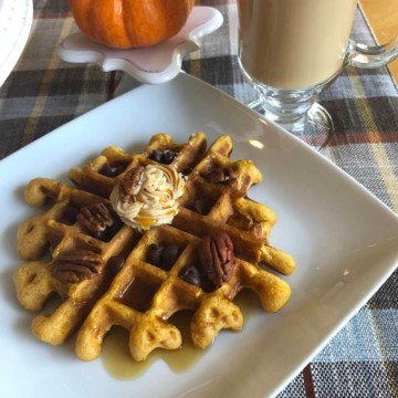 homemade pumpkin buttermilk waffles with pecans, chocolate chips, cinnamon butter, and maple syrup