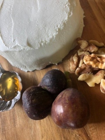 Homemade Greek yogurt cream cheese with honey, figs, and walnuts