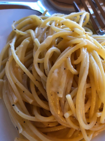 cheese and pepper noodles, close up (cacio e pepe)