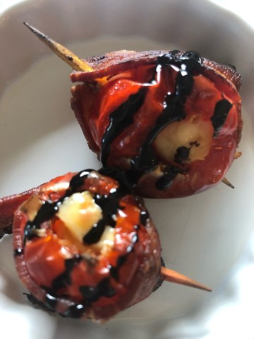 peppadew peppers stuffed with cream cheese wrapped in bacon and drizzled with balsamic reduction