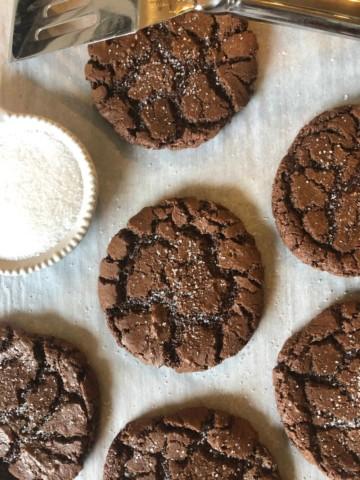 brownie crinkle cookies with sea salt sprinkled over the top