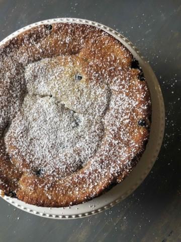 blueberry yogurt cake with dusting of powdered sugar
