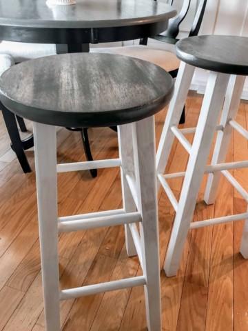 refinishing old bars stools to create a farmhouse look, picture of bar stools with white distressed base and weathered grey seats