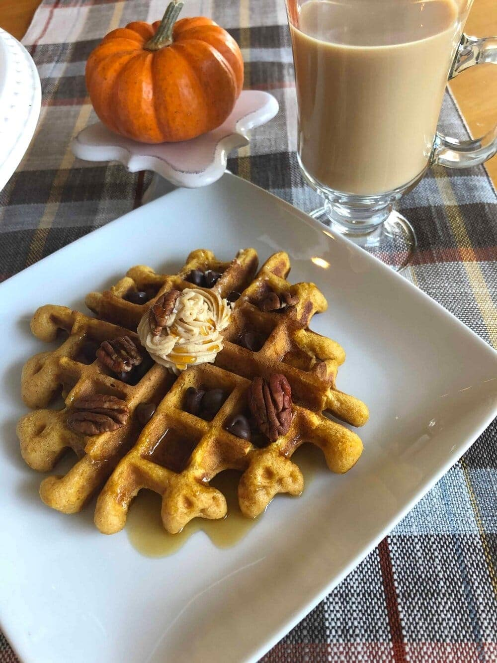 Missouri Girl Blog. Pumpkin Buttermilk Waffles with maple cinnamon butter. So amazing! Imagine a spiced pumpkin waffles with melty maple butter, chocolate, and pecans on top. So good and makes the perfect addition to any Holiday, Fall, or Winter breakfast, #pumpkinbuttermilkwaffles #waffles #holidaybreakfast #breakfast #Christmasbreakfast