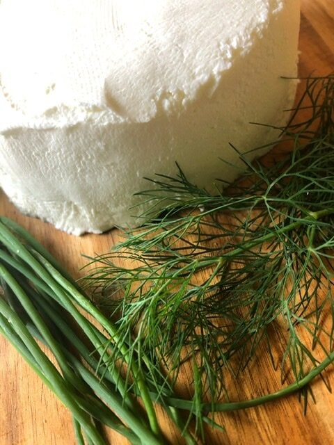 Homemade Greek yogurt cream cheese with chives and dill