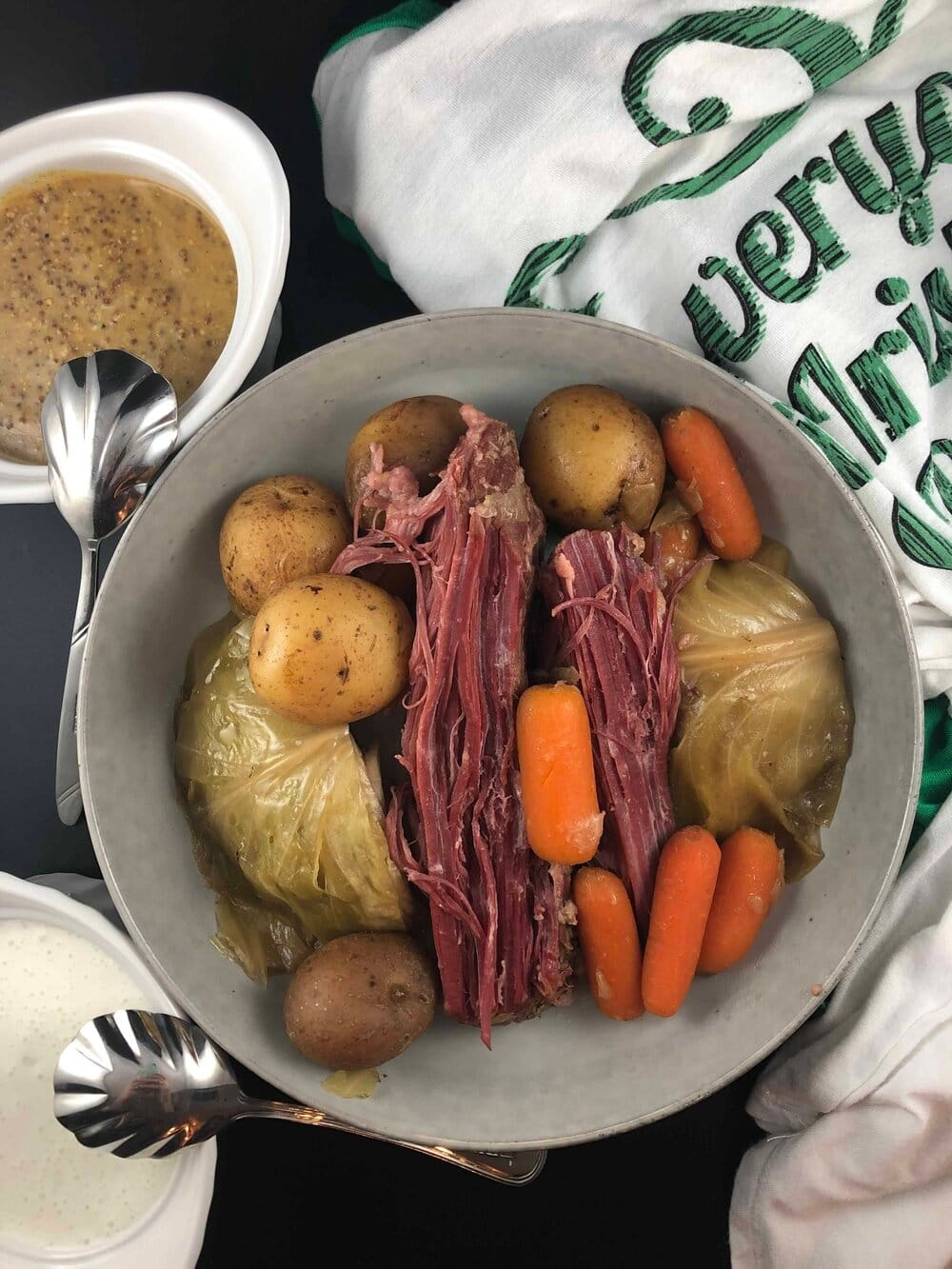 This corned beef is so good and so easy. Just throw everything into the crockpot and 10 hours later you have perfectly cooked corned beef and vegetables. This beef and vegetables is cooked in a Guiness broth and served with a dill pickle horseradish cream and a stone ground guiness mustard. Missouri Girl. Missouri Girl Blog.