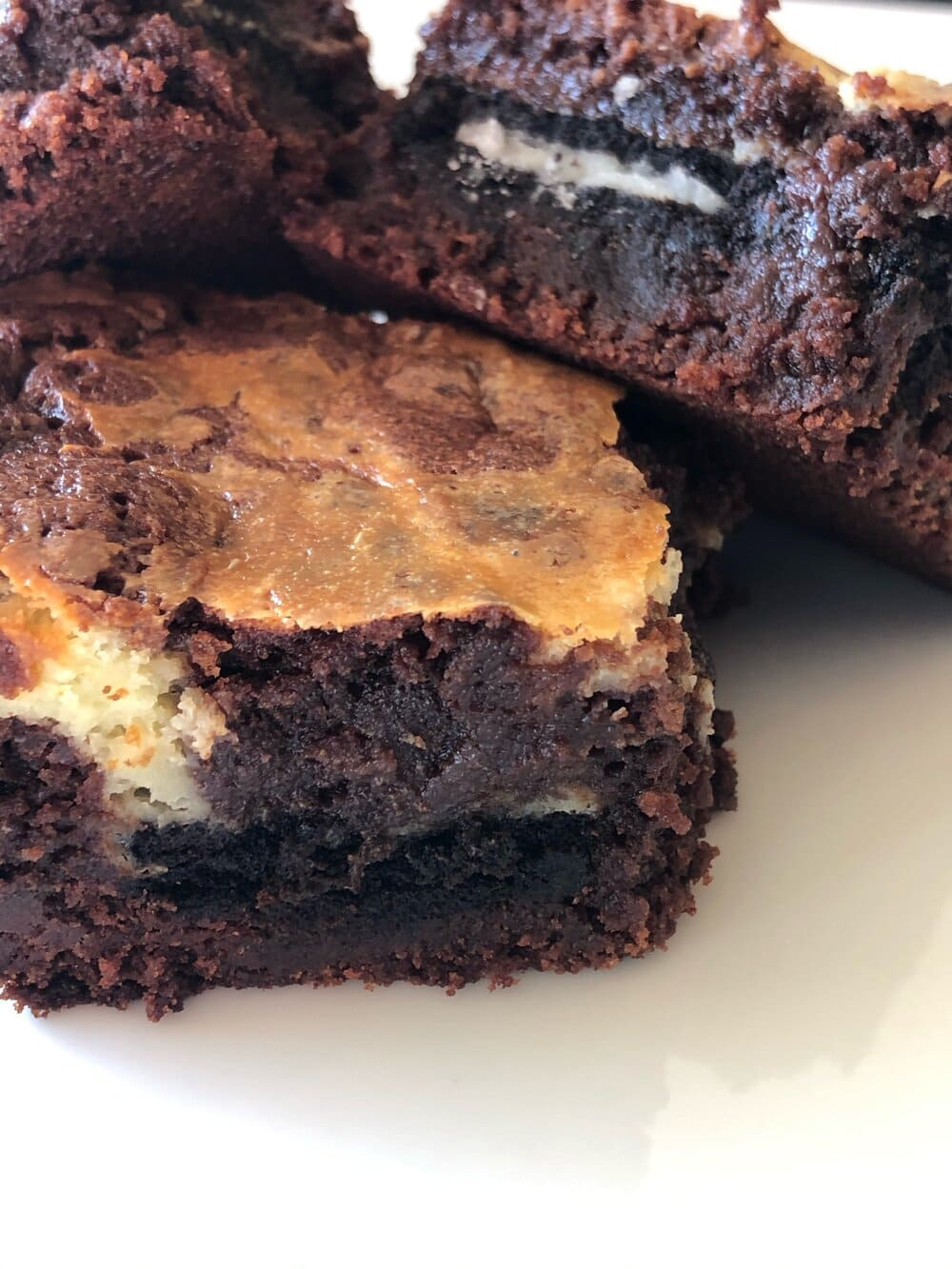 """Missouri girl cheesecake oreo brownies. Missouri girl. Missouri Girl blog. """"better than boxed brownie"""" batter with creamy cheesecake and oreos baked right into the middle. So good."""