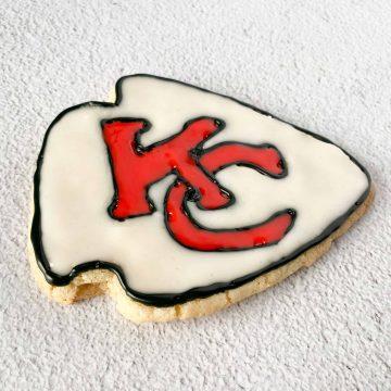 Chiefs arrowhead cookies on a cookie sheet
