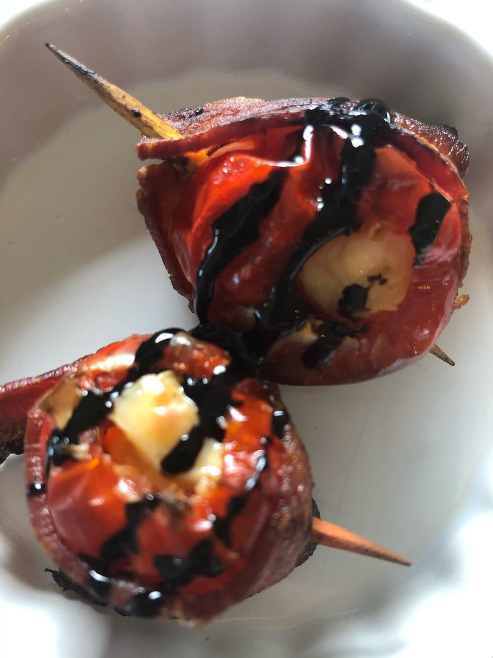 Missouri Girl Peppadew Peppers. Sweet peppadew peppers stuffed with a creamy cream cheese, wrapped in crispy bacon, and topped with a balsamic reduction. So good.