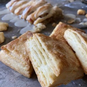 flakey, light, and airy layers of homemade rough puff pastry dough, pastry squares, leaf pastry designs and apple strudel