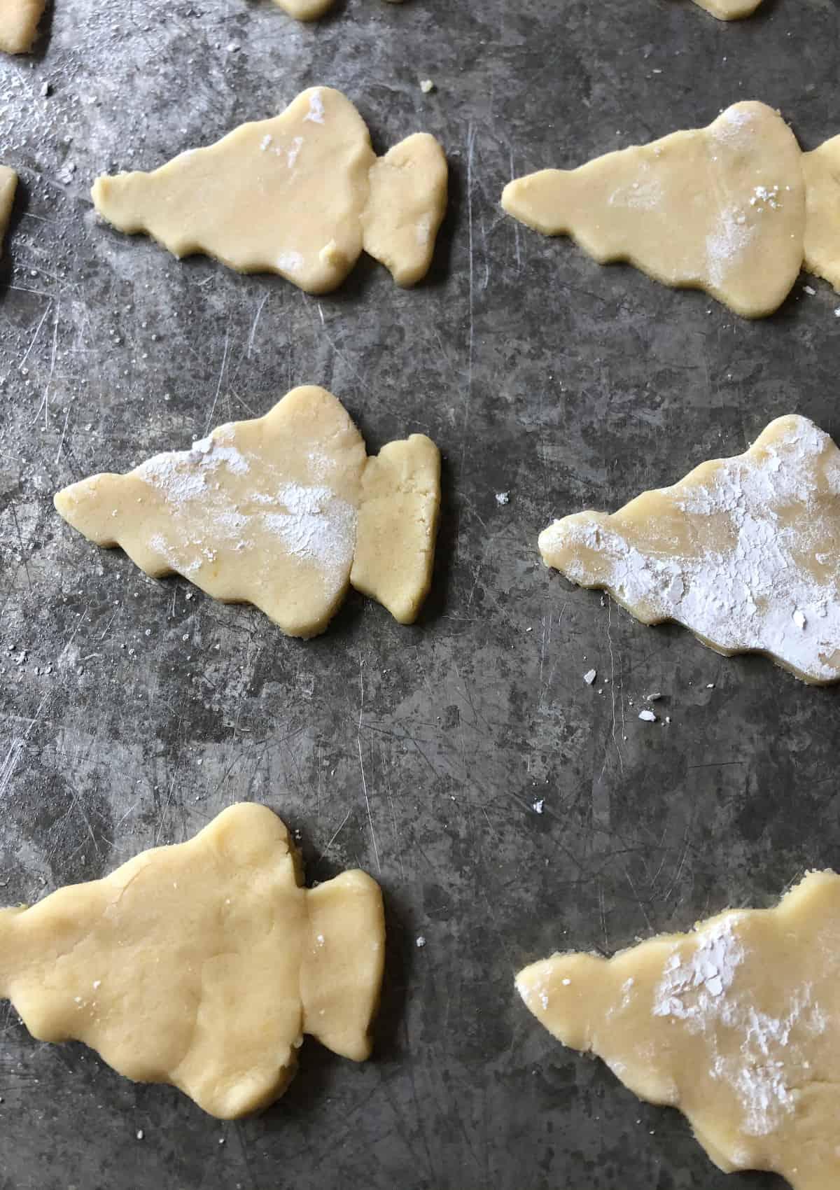 arrowhead cookie dough on a cookie sheet