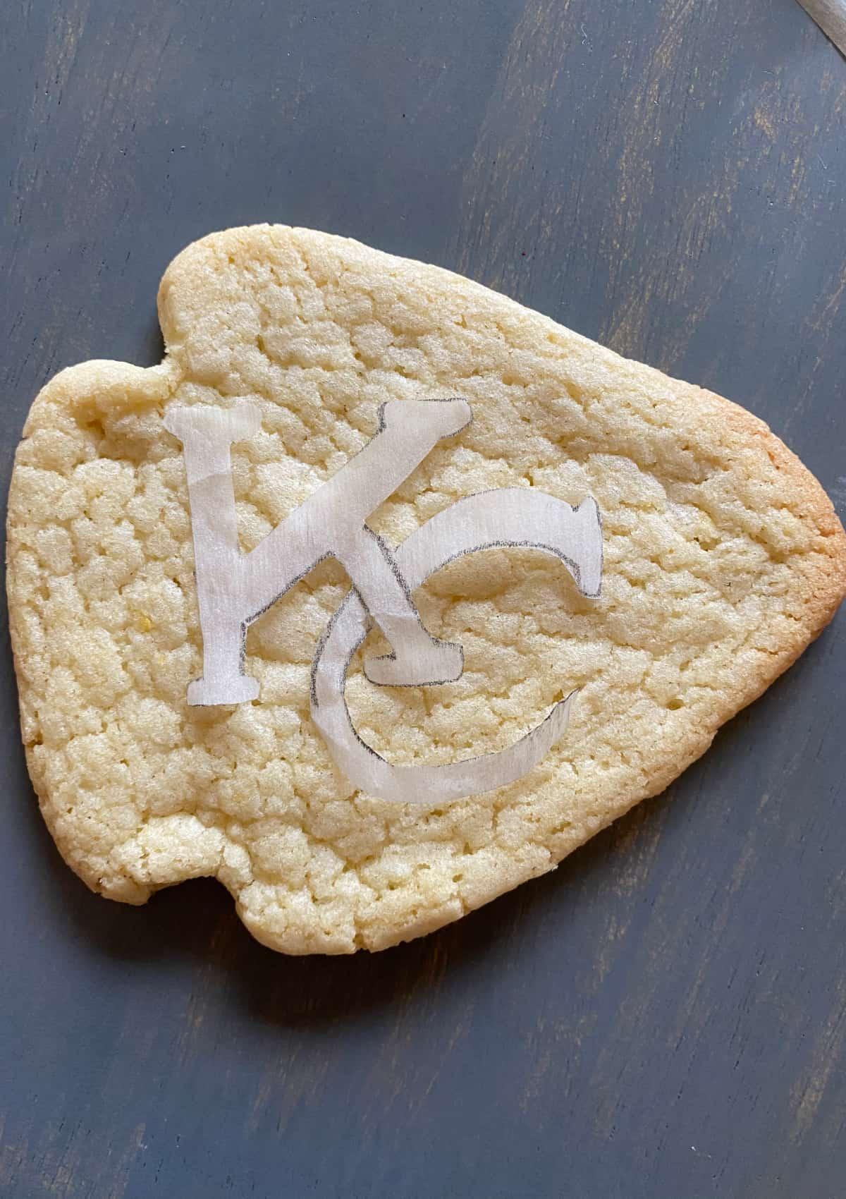 stenciling the Chiefs logo onto an arrowhead sugar cookie