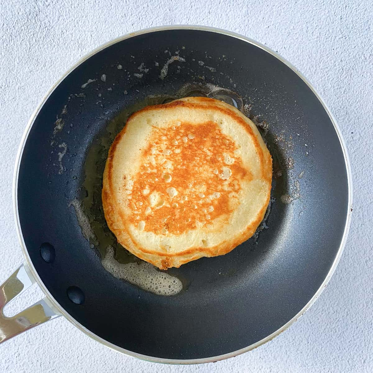 a perfectly browned and golden olive oil buttermilk pancake