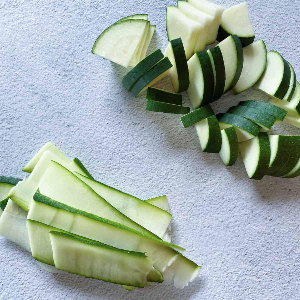 cut and quartered zucchini and zucchini ribbons