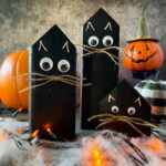 diy halloween black cat decor with 3 black cats and halloween decor in the background