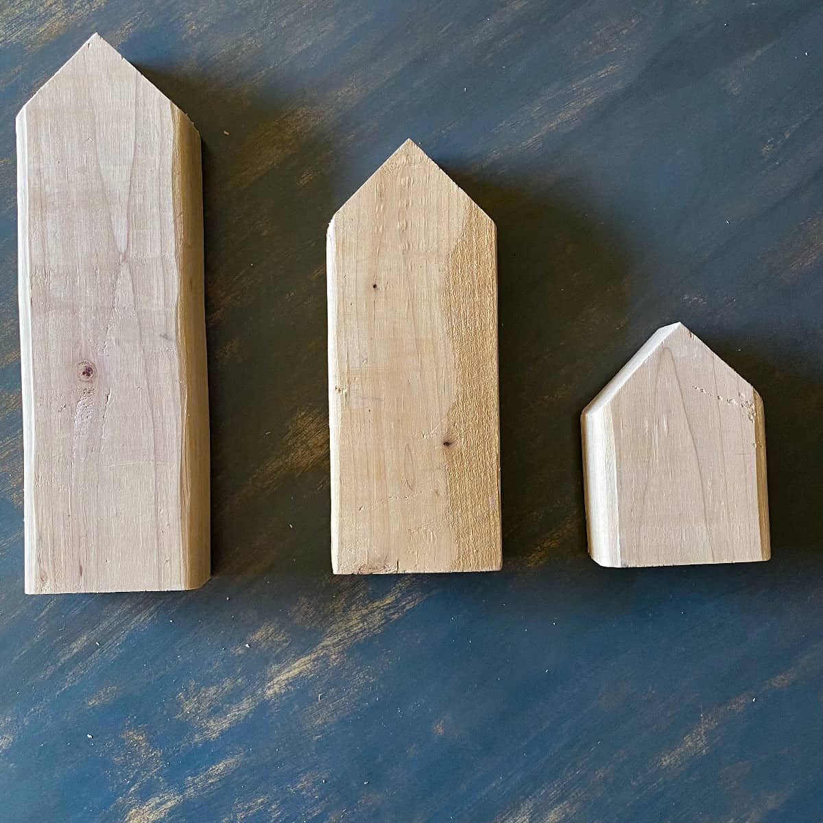 angles cut on 2x4 wood boards in preparation for making halloween black cat wood block decor