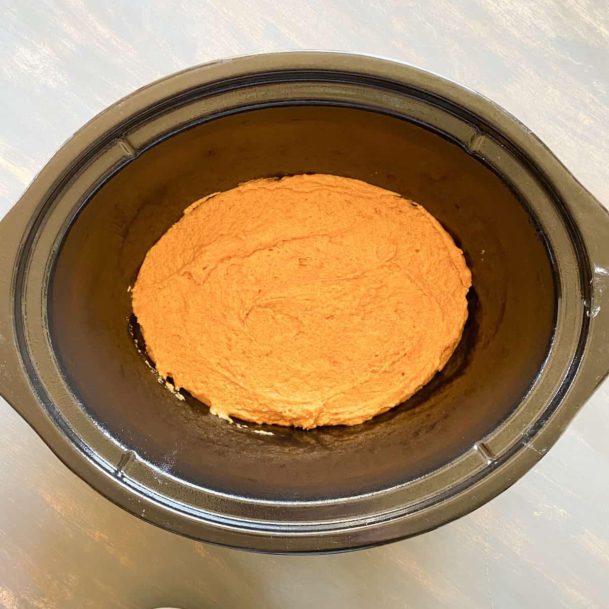 pumpkin cobbler batter in a crockpot